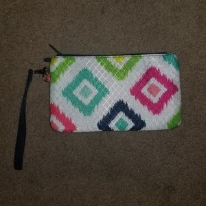 Thirty one white and green clutch